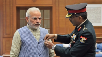 Prime Minister Narendra Modi met officers at the Kendriya Sainik Board, where he was pinned with a flag by Brigadier MH Rizvi, the Secretary of the board.