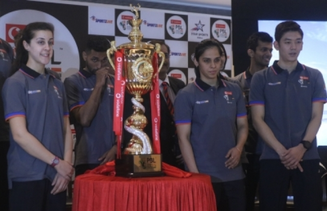New Delhi: Badmonton players Saina Nehwal, Carolina Marin and other dignitaries during a programme organised to unveil Premier Badminton League (PBL) Trophy in New Delhi on Dec 20, 2017. (Photo: IANS)