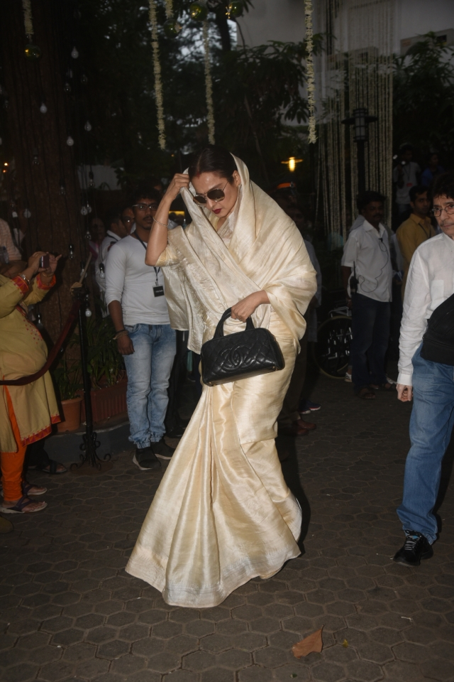 Rekha arrives for the service.