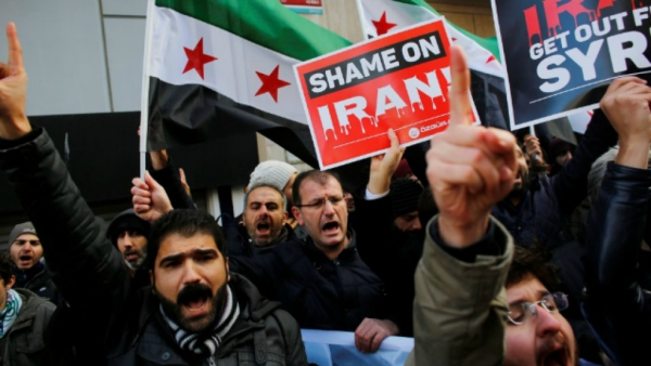 Demonstrators shout slogans during a protest against Iran's role in Aleppo, near the Iranian Consulate in Istanbul, Turkey.
