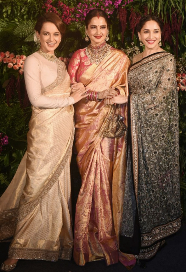 Kangana Ranaut, Rekha and Madhuri Dixit pose for the paps.