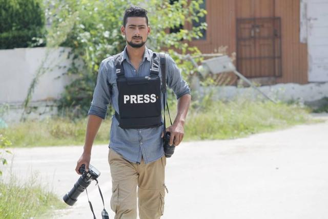 <p>21-year-old photojournalist Kamran Yousuf</p>