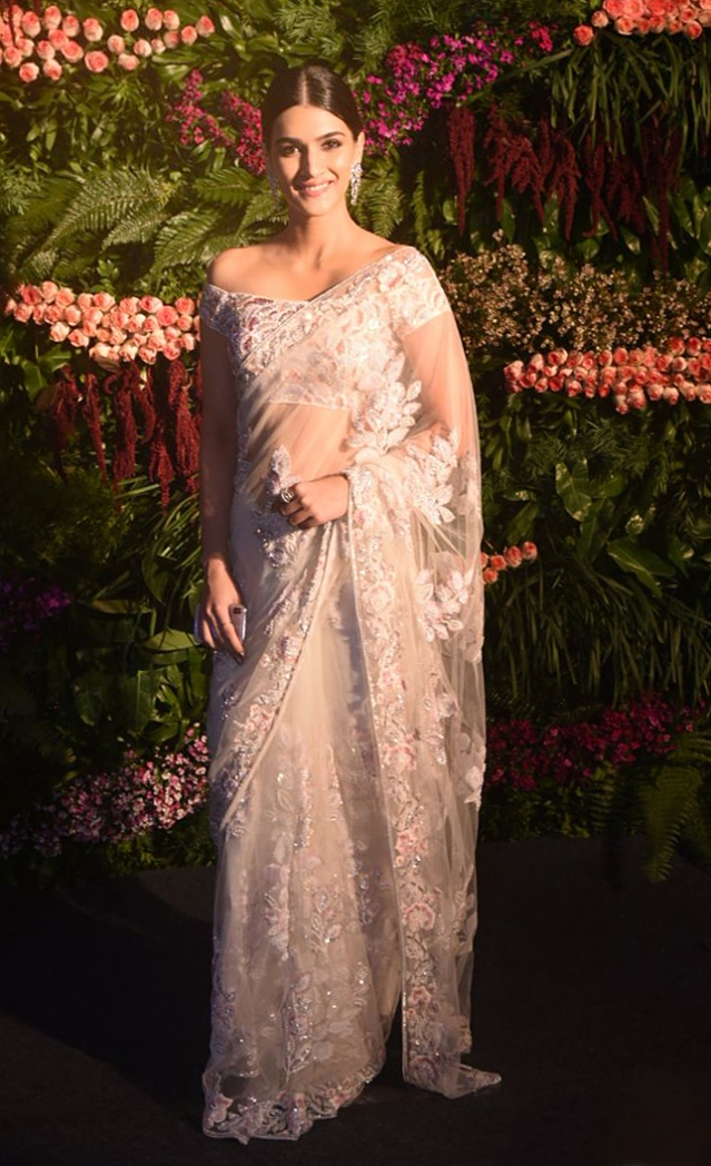 Kriti Sanon donned a white saree for the occasion.