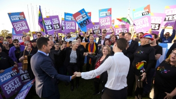 Same-sex marriage campaigners cheer during rally outside Parliament House in Canberra, Australia.