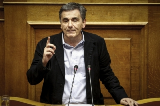 ATHENS, Dec. 20, 2017 (Xinhua) -- Greek Finance Minister Euclid Tsakalotos addresses lawmakers during the parliament