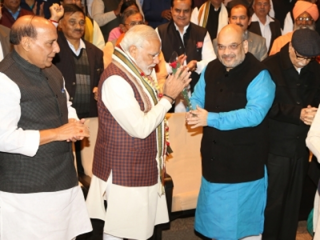 New Delhi: BJP president Amit Shah greets Prime Minister Narendra Modi during the BJP Parliamentary Party meeting at Parliament House in New Delhi on Dec. 20, 2017. Also seen Union Minister Rajnath Singh and other leaders. (Photo: Amlan Paliwal/IANS)