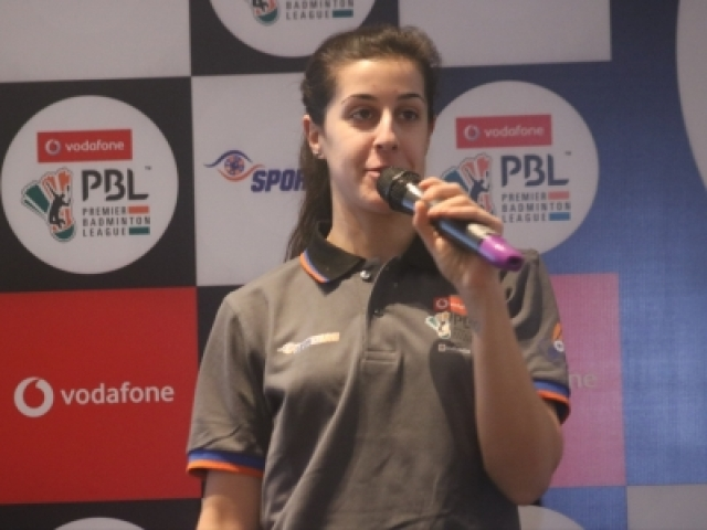 New Delhi: Spanish badminton player Carolina Marin addresses during a programme organised to unveil Premier Badminton League (PBL) Trophy in New Delhi on Dec 20, 2017. (Photo: IANS)