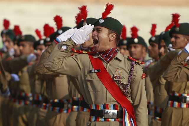 A National Cadet Corps member gives a command during a rehearsal of the Republic Day parade in Jammu, India, Wednesday, 24 January 2018.