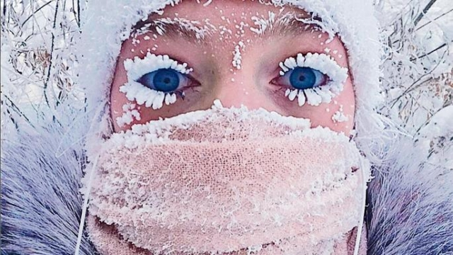 Woman clicks a selfie with her frozen eyelashes.