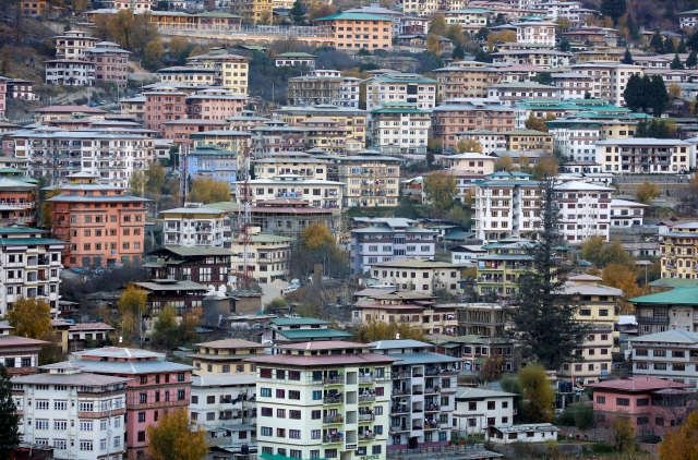 Houses stand in the capital city of Thimphu, Bhutan, 11 December  2017.