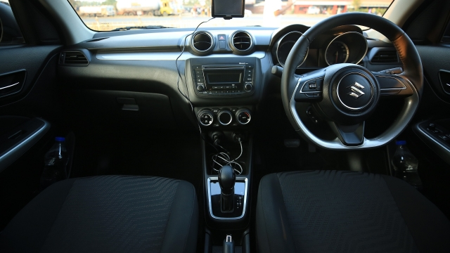 The interiors of the V variant. It gets a regular Bluetooth-enabled audio system with steering audio controls.