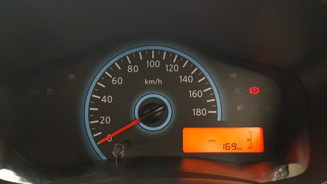 While driving you'll see the gear switching on the left of the small orange-coloured screen.