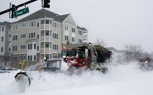 Trucks clear the streets during Storm Grayson at the Jersey shore in Sea Bright, New Jersey.