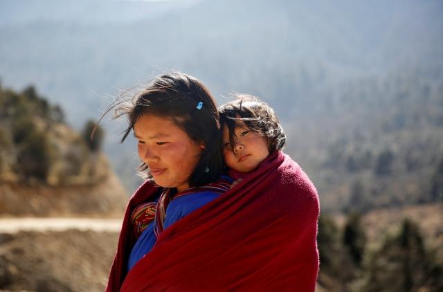 A woman carries her daughter near Punakha, Bhutan, 14 December 2017.