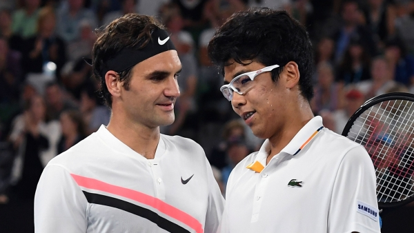 Switzerland's Roger Federer, left, is congratulated by South Korea's Hyeon Chung after their semi-final match.