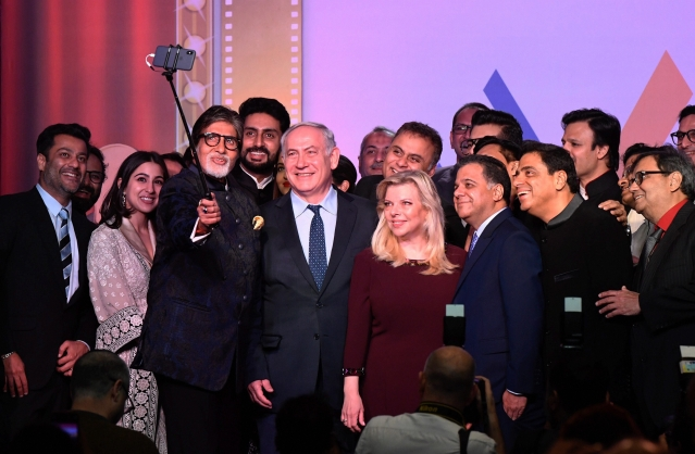Israeli Prime Minister Benjamin Netanyahu takes a selfie with Bollywood personalities during 'Shalom Bollywood' on Thursday.