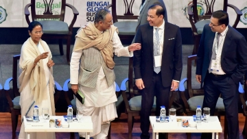 West Bengal CM Mamata Banerjee, Finance Minister Amit Mitra, Pranav Adani Managing Director, Adani Wilmar and Chairman of RP Sanjiv Goenka Group Sanjeev Goenka at Bengal Global Business Summit 2018, in Kolkata, on Wednesday.