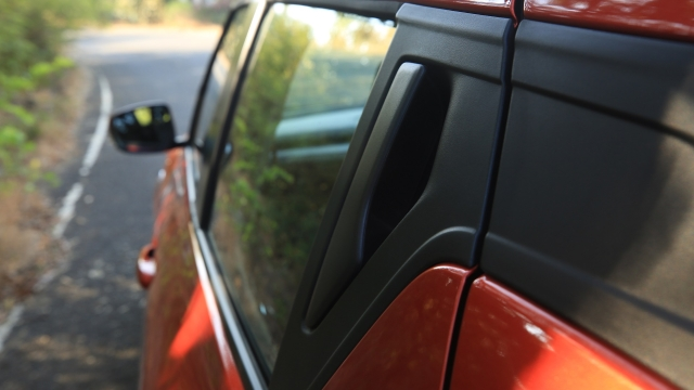 The rear door handle is on the C-pillar, like the Chevrolet Beat and Mahindra KUV100.