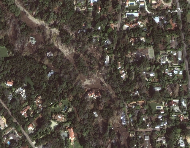 Satellite image released by DigitalGlobe News Bureau shows an area of homes after storms caused mudslides and flooding in Montecito, California.