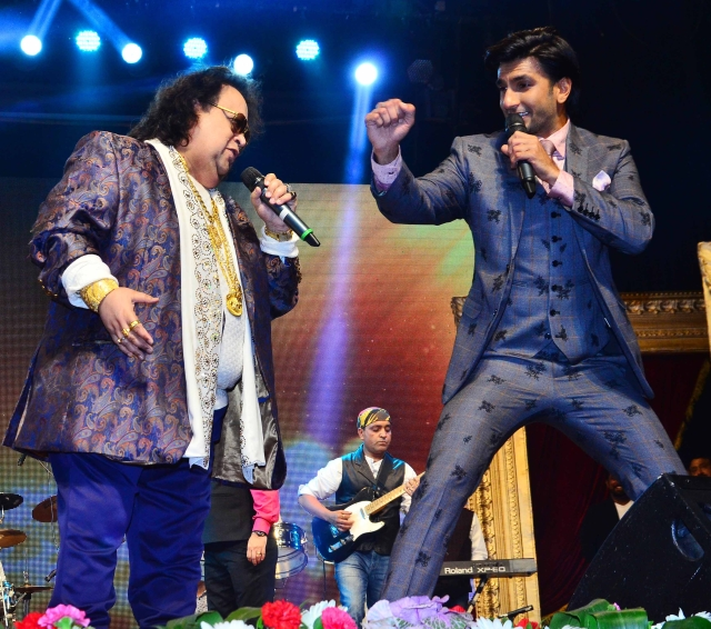 Two charismatic showboaters in one frame - Ranveer Singh and Bappi Da!