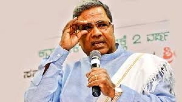 CM Siddaramaiah  distributed free laptops to  SC/ST college students with his photo pasted on the gadgets.