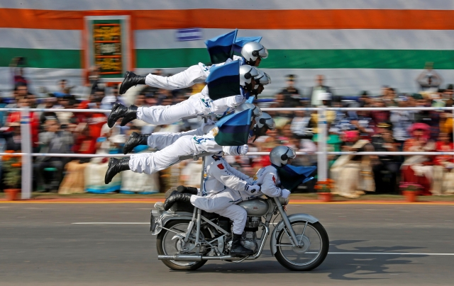 "Indian Army ""Daredevils"" motorcycle riders perform during the Republic Day parade in Kolkata, India, 26 January 2018."