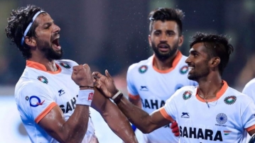 Rupinder Pal Singh celebrates a goal with his teammates.