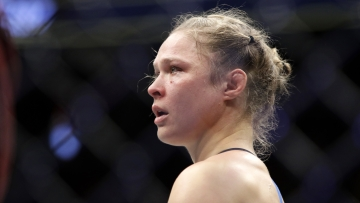 In this Dec. 30, 2016, file photo Ronda Rousey stands in the cage after Amanda Nunes forced a stoppage in the first round of their women's bantamweight championship mixed martial arts bout at UFC 207 in Las Vegas. Rousey's next fight could come in a WWE ring.