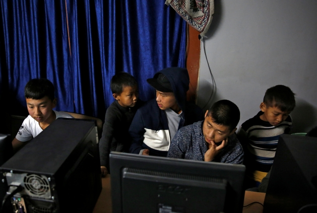 Youths gather in an internet gaming centre in the capital city of Thimphu, Bhutan, 11 December 2017.