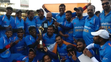 The Indian team pose with the Blind Cricket World Cup.