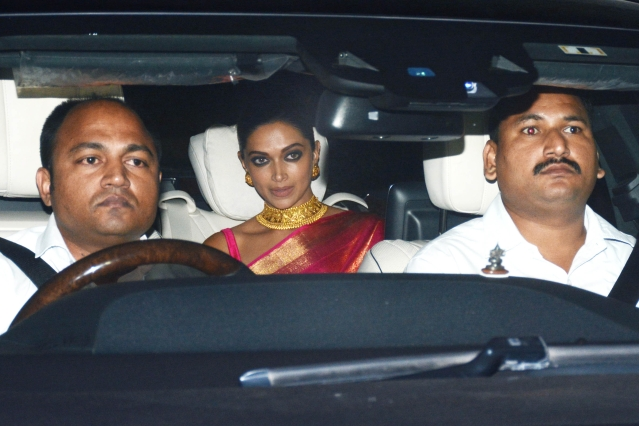 Deepika Padukone takes the backseat as she is driven into the venue.