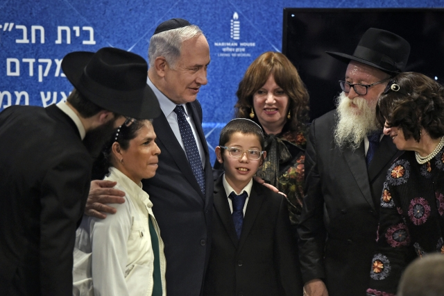 Israeli Prime Minister Benjamin Netanyahu with Mosche Holtzberg, his nanny and grand-parents after unveiling the Living Memorial in commemoration of the victims of the 26/11 attacks, at the Chabad House in Mumbai on Thursday.