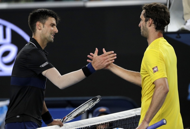 Serbia's Novak Djokovic, left, is congratulated by Spain's Albert Ramos-Vinolas after their third round match.