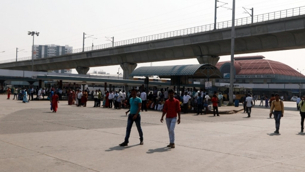 Commuters stranded at a bus depot as bus services are curtailed due to a strike called by crew members belonging to employees unions on disagreement to wage accord in Chennai.