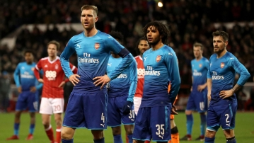Arsenal's Per Mertesacker and Mohamed Elneny are dejected during the FA Cup match against Nottingham Forest.