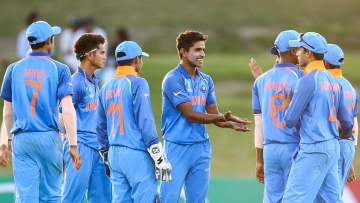 Shivam Mavi of India celebrates with teammates after taking the wicket of Jonathan Merlo of Australia during the ICC U19 Cricket World Cup match between India and Australia at Bay Oval on January 14, 2018 in Tauranga, New Zealand.
