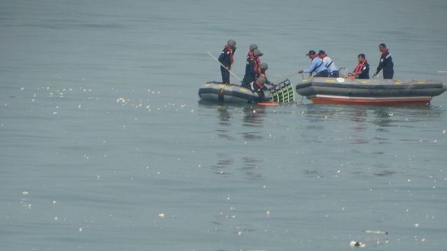 The Chopper's debris being pulled out of water.