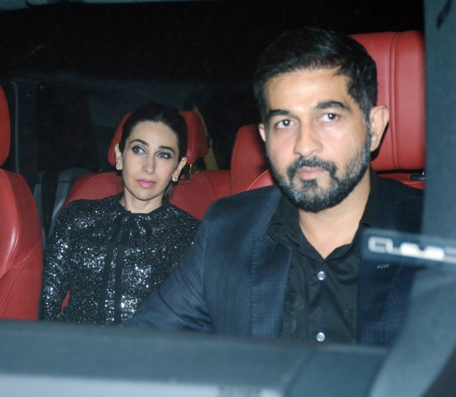 Kareena Kapoor wears black for the party.