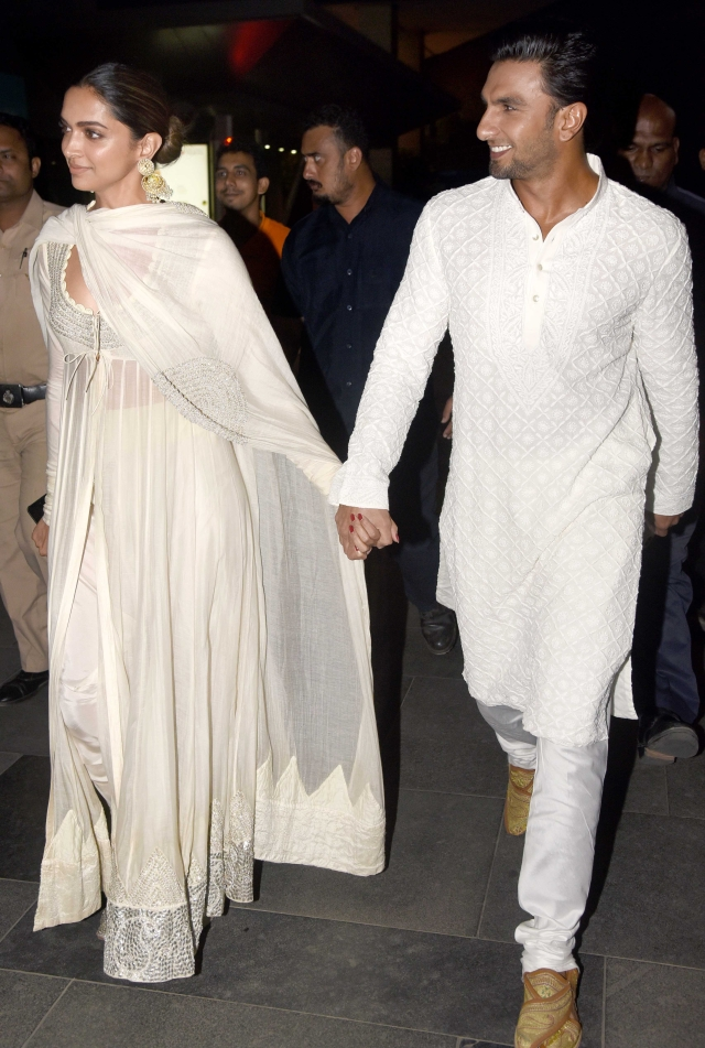 Deepika and Ranveer look relieved after the Karni Sena called off its agitation.
