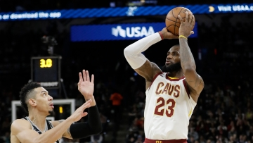Cleveland Cavaliers forward LeBron James shoots and scores over San Antonio Spurs guard Danny Green.