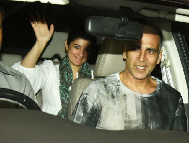Debut producer Twinkle Khanna waves to the media.