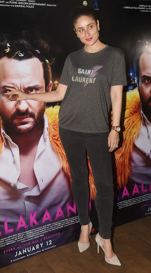 Kareena poses with a poster of Saif.