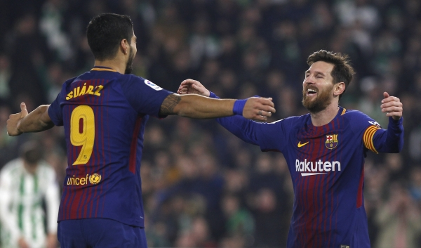File picture of Barcelona stars Lionel Messi and Luis Suarez celebrating during a La Liga game against Real Betis.