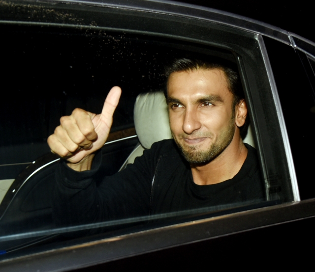 Ranveer Singh gives a thumbs up to the media.