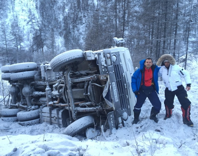Car topples on the snow clad road of Oymyakon