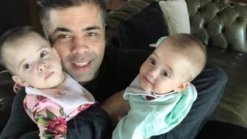 Karan Johar being the doting dad to his twins.