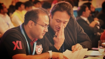 Kings XI Punjab's mentor Virender Sehwag and co-owner Ness Wadia discuss a player during the IPL Auction 2018.