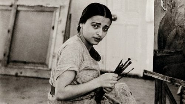 Amrita Sher-Gil in front of her canvas.