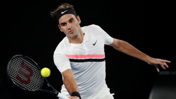 Switzerland's Roger Federer makes a forehand return to France's Richard Gasquet during their third round match.