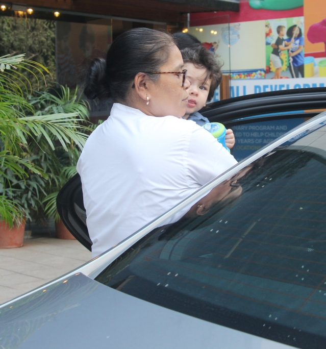 """Bye paps! I could wave goodbye but you see my hands are too full. Happy shadowing. Some royal duties await. Ta Ta!"" - Taimur"
